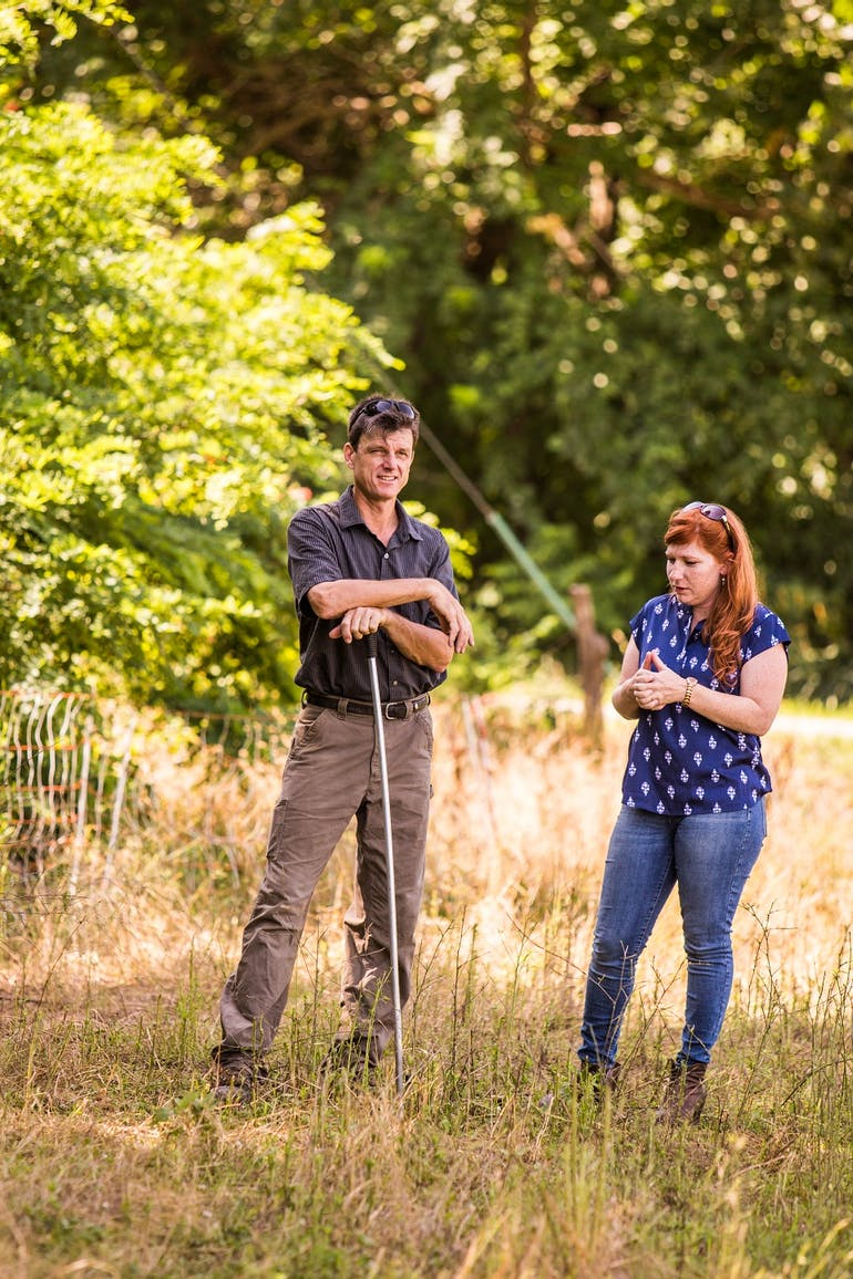 John and Lucinda discussing farmer network
